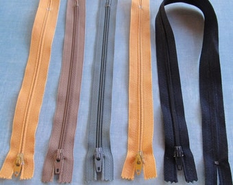 ZIPPERS --lot of 5--  (four 9in., one 18in.)  butter yellow, taupe, cornflowerblue, black