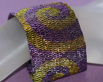 Swirls of Deep Purple and Bronze ... Peyote Cuff . Bracelet . Beadwoven . Regal . Royalty . Sensual . Luxurious . Spirals . Elegant