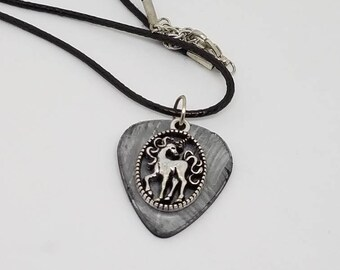 Unicorn necklace made from a vinyl record