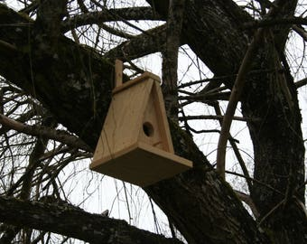 Birdhouse made of untreated pine wood triangle