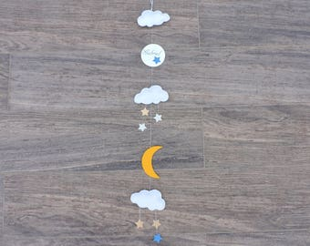Garland with vertical name with clouds and moon