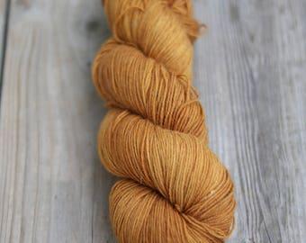 SOCK yarn, 75/25 superwash merino/nylon, onion skins over parmelia saxatilis lichen