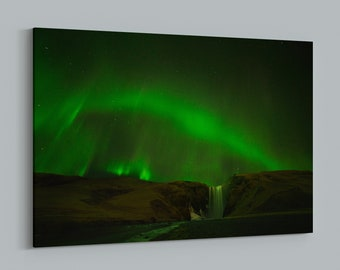 Northern Lights in Iceland - Aurora Borealis above waterfall canvas print