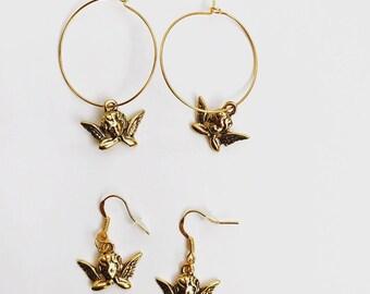 The cherub earrings in gold