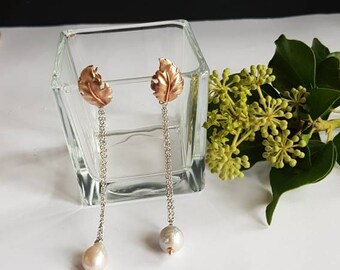 Earrings with leaves at base and river Pearls