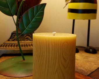 Handmade 100% pure beeswax candle with wood grain design