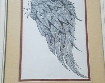 Feather wing pencil and pen artwork.