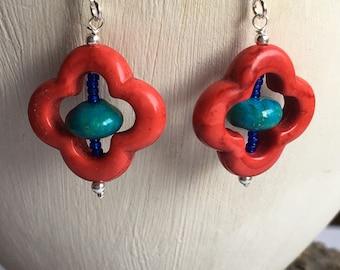 Red quatrefoil earrings