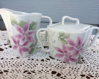 Creamer and Sugar bowl hand painted porcelain with Clematis flowers