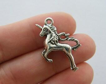 4 Unicorn charms antique silver tone A498