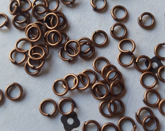 4mm Antiqued copper jumprings (100)