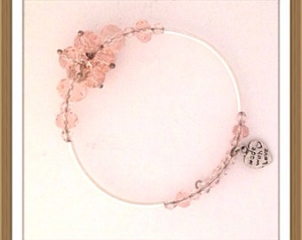 Bracelet by MWL pink faceted beads with silver tube beads. Handmade 0222