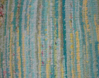 """Bright and colorful handwoven braided rug, 25"""" x 32"""""""