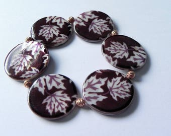 Printed burgundy and white shell bracelet with rose gold coloured spacers