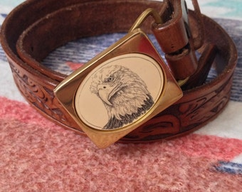Tooled leather belt with brass eagle buckle