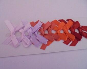 Knots satin purple and orange 3 x 4 cm