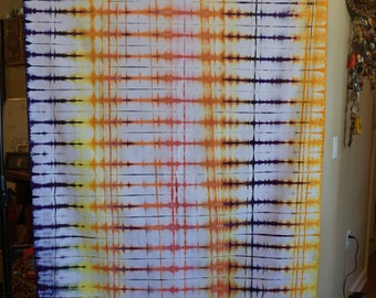 Accordion dyed Kona Cotton in red, yellow, orange and purple. 56' x 41'