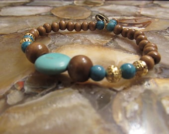blue stretchy bracelet with golden charms