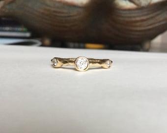 Diamond 14k bezel yellow gold band ring