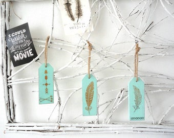 Reclaimed wooden wall pendant in sea green with golden images. Sisal hanging. Three different images. Native style.