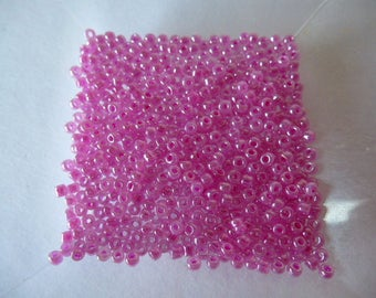 500 2.2 mm purple glass Pearl colored seed beads