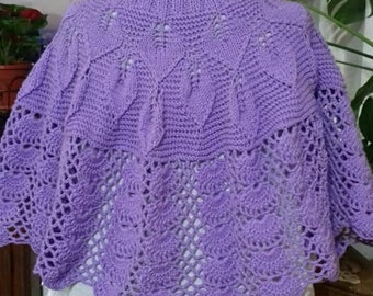Handknit cape with crochet lace
