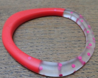 Red resin wangle bangle with cerise dots