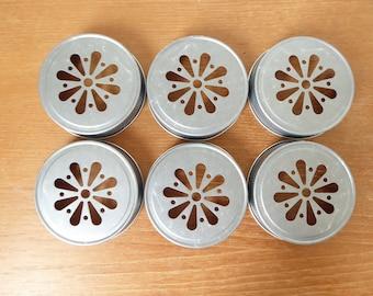 Six daisy mason jar lids in pewter tone, fits standard mason jar, 24 available