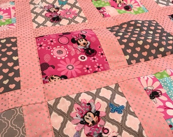 Pink Minnie Mouse baby blanket.