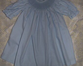 Hand Smocked night gown for newborn baby.