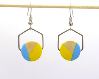 Hexagon earrings with silver tone and light blue and pale yellow painted wood round.
