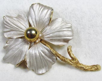Designer signed Pastelli gold metal frosted white enamel brooch pin.