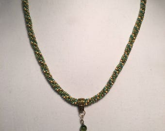 Hand beaded green and gold necklace