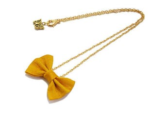 Bow tie, silk, yellow, gold chain short necklace.