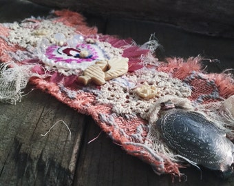 Tattered textile and vintage embroidered cuff with vintage lace and bone beads in pink and cream | hand sewn  textile assemblage