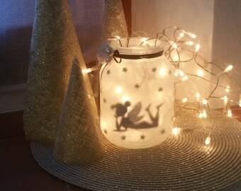 Fairy lying with led tealight Lantern