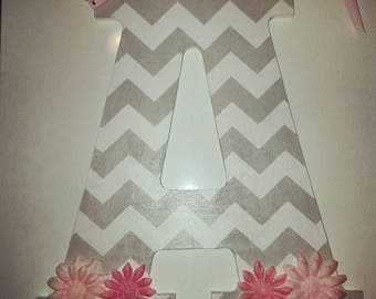 """Gray Chevron 13"""" wood letter embellished with pink paper flowers."""