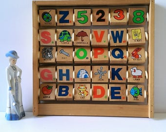Children's alphabet learning toy with spinning letters and symbols
