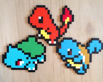 Bulbasaur, Charmander and Squirtle wall hanging. Handmade wooden pixel art.