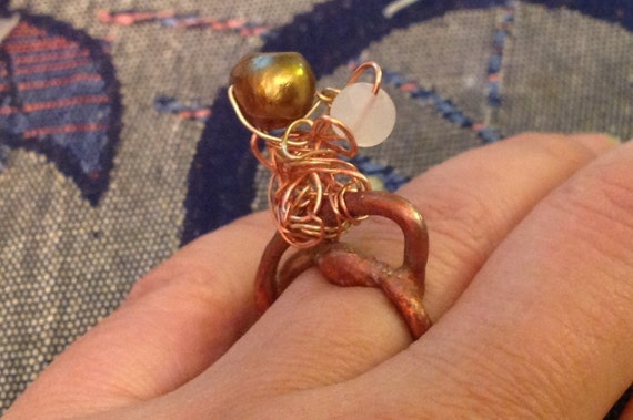ring Golden pearl and opal gem stone in  copper and golden colored metal work