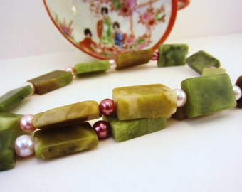 Jade green beaded necklace with shades of pink faux pearl spacers. Natural green serpentine flat beads. Statement jewelry.