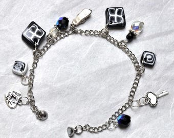 Graphic black and white bracelet, charm and millefiori