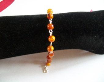 Pearl bracelet with genuine amber