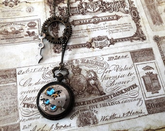 Mechanical designer pendant necklace antique vintage style cabochon mechanism steampunk watch gear COG needle blue rhinestones retro