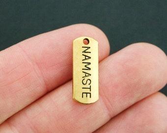 8 Namaste Charms Antique Gold Tone - GC631