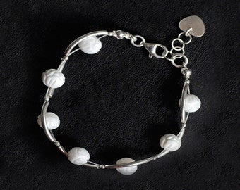 Carved white mother-of-Pearl and silver bracelet.