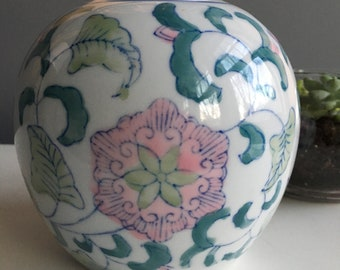 Large vintage ginger jar with pink flowers and green leaves and vines