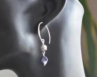 Silver earrings with dark purple Swarovski element.