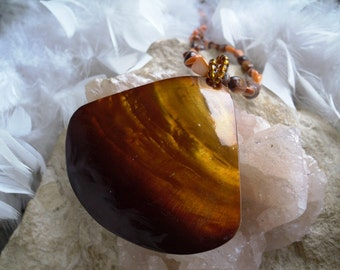 Large Triangular shell pendant with brown and orange MOP beads