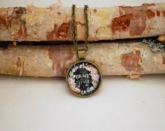 Grace upon grace, Small Bronze Pendant Necklace